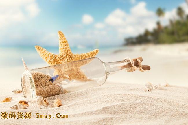 唯美清新沙滩漂流瓶背景高清图片