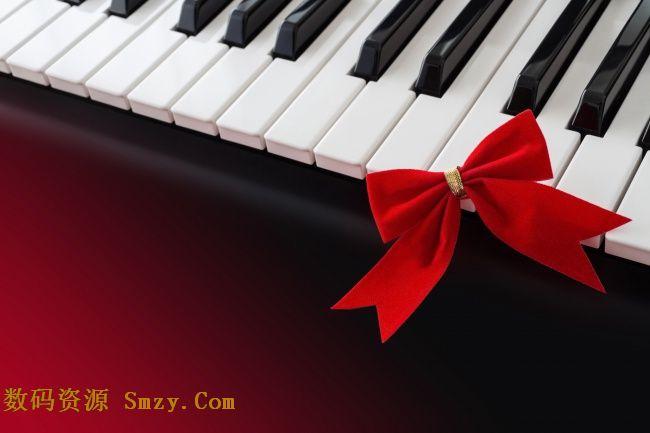 钢琴黑白琴键搭配红色蝴蝶结高清图片